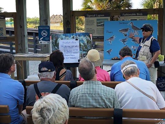 Susan Kubat describing winter resident birds.