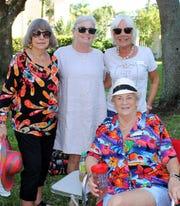 Marilyn Sonderman, Ricki Terzis and Joanie Brannick admire Dottie Danials Cuba attire.