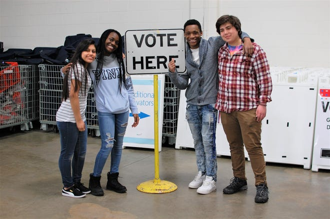 Students work at a polling place in Minneapolis.