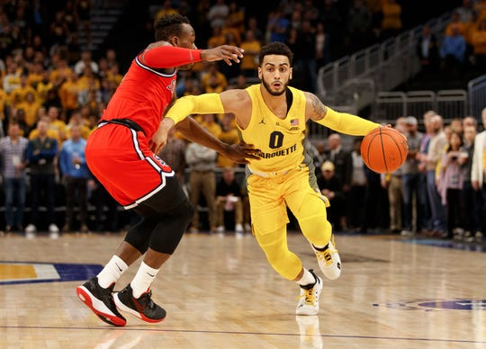 Markus Howard tries to drive past St. John's guard Rasheem Dunn Tuesday night. Howard led the Golden Eagles with 32 points.