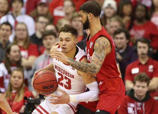 Badgers guard Kobe King tries to back down Cornhuskers guard Charlie Easley during the first half.