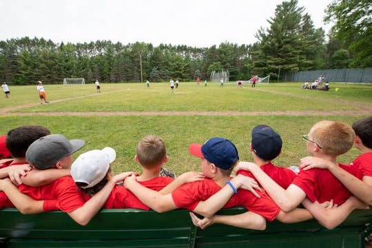 Boys form lifelong friendships at Red Arrow Camp, where activities like baseball have been around since the camp's founding in 1920.