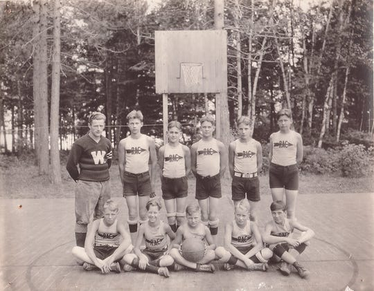 Rollie Williams, back left, was Red Arrow Camp's first athletic program director. He was the University of Wisconsin's first nine-letter athlete.
