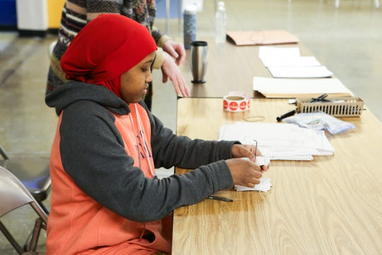 Minneapolis student Miski Mohamed works at a polling place Jan. 21.