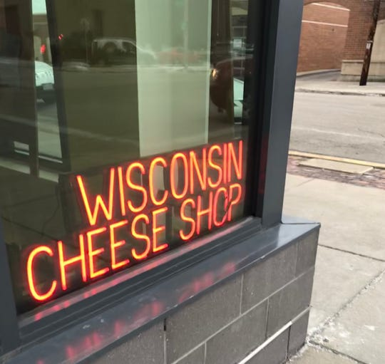 A neon sign at South Second and West Bruce streets alerts passers-by that inside is Clock Shadow Creamery, a store but also the only cheese factory within Milwaukee city limits.