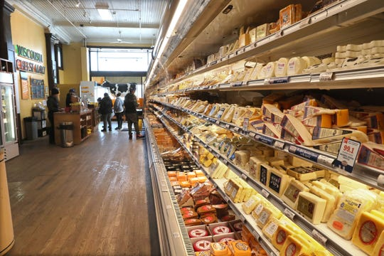 A display case stocked with scores of cheeses, most from Wisconsin, runs nearly the length of  Wisconsin Cheese Mart, 215 W. Highland Ave. at Old World Third Street.