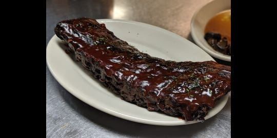 Braising barbecued ribs gives them great flavor, says steakhouse chef
