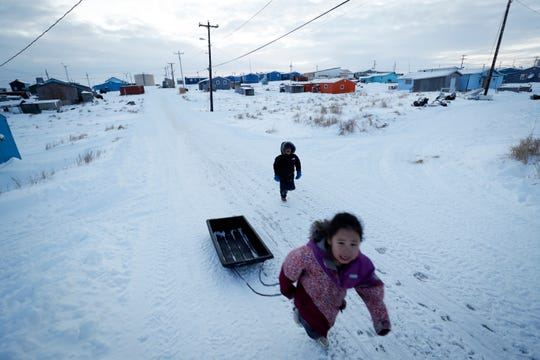 Children play in the snow Saturday in Toksook Bay, Alaska. The first Americans to be counted in the 2020 Census live in this Bering Sea coastal village. The Census traditionally begins earlier in Alaska than the rest of the nation because frozen ground allows easier access for Census workers, and rural Alaska will scatter with the spring thaw to traditional hunting and fishing grounds.