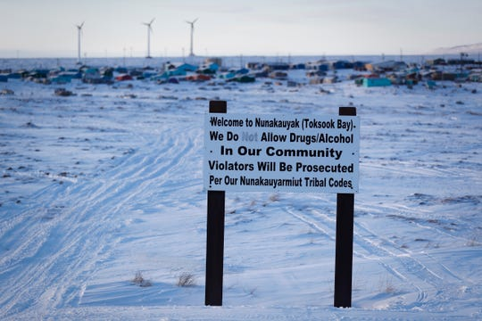 A sign displays a warning about using drugs and alcohol in Toksook Bay, Alaska. The U.S. Census' count of the American population begins in this Bering Sea coastal village.
