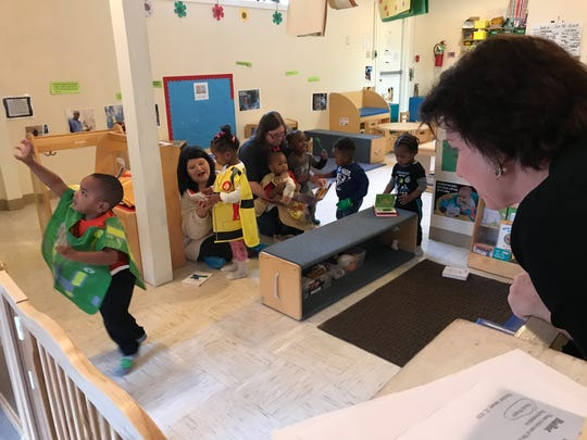 Lynn Clark, executive director of the Children's Coalition of Northeast Louisiana, talk to a student at the Filhiol Avenue Early Head Start location on Wednesday during a tour by the Louisiana Department of Education highlighting successful early childhood education centers around the state.