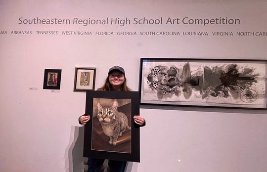 """Isabella Standard was present for accept her $100 prize for """"This Paw-ful Cat"""" at the 2020 Biennial Southeastern High School Artist Competition in Birmingham, Alabama."""