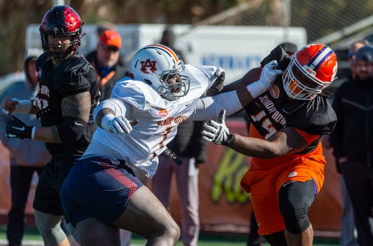 South defensive end Marlon Davidson of Auburn (7) spars with South offensive guard John Simpson of Clemson (74) during Senior Bowl practice on Jan. 21, 2020, in Mobile.