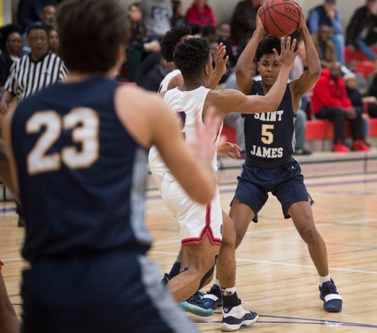 St. James' Bradley Thomas (5) looks to pass at Pike Road High School in Pike Road, Ala., on Tuesday, Jan. 21, 2020.
