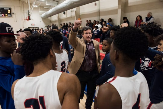 Pike Road coach Robb McGaughey huddles with his team before taking on St. James at Pike Road High School in Pike Road, Ala., on Tuesday, Jan. 21, 2020.