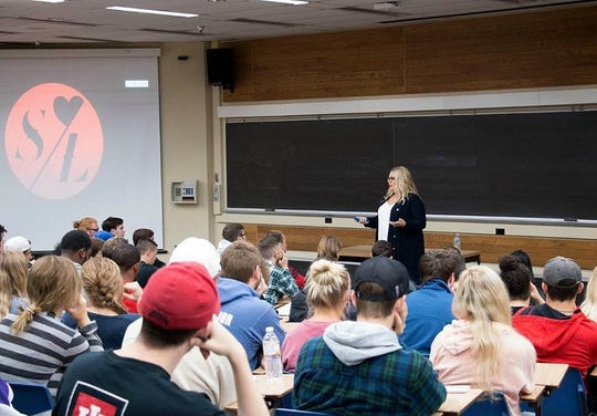 Kimberly Majeski, founder of Stripped Love, speaking with students about her organization at Ball State University.
