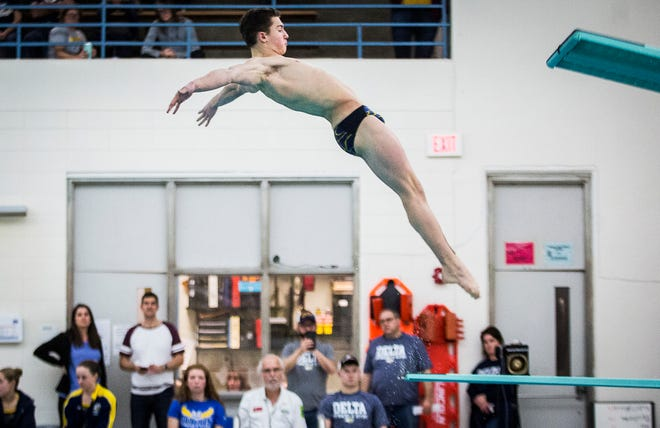 Delta's Sam Bennett dives during the team's swim meet against Burris at Delta High School Tuesday, Jan. 21, 2020.