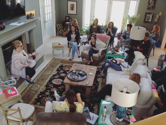 Stripped Love Founder Kimberly Majeski speaking with volunteers during an annual team retreat circa 2016.