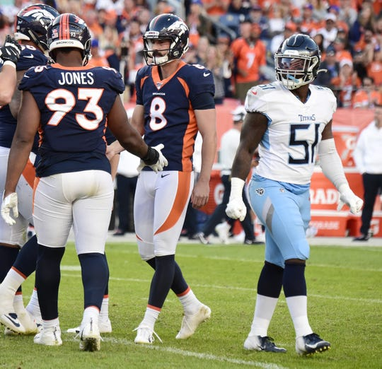 Denver Broncos kicker Brandon McManus (8) is congratulated after his field goal as Tennessee Titans linebacker David Long (51) walks by during the fourth quarter at Empower Field at Mile High Sunday, Oct. 13, 2019 in Denver, Colo.