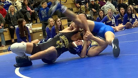 Fairview's Kendrick Curtis runs a near side cradle for a pin over Brentwood's Kayvon Arab at the 152 pound weight class at Nolensville High on Jan. 21, 2020.