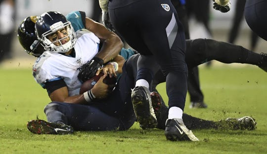 Tennessee Titans quarterback Marcus Mariota (8) is sacked by Jacksonville Jaguars defensive end Calais Campbell (93) on a fourth-and-six play during the third quarter at TIAA Bank Field Thursday, Sept. 19, 2019 in Jacksonville, Fla.