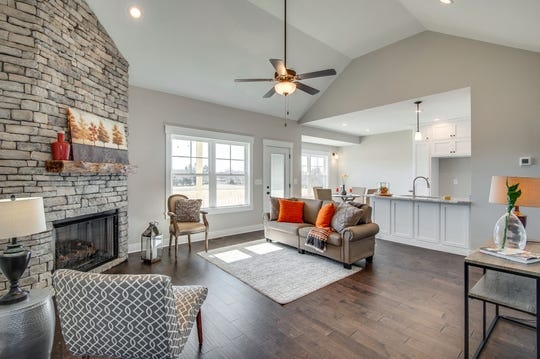 The home listed by Scott England at 1026 Hayshed Road has an open floor plan, a stone fireplace and a high ceiling.