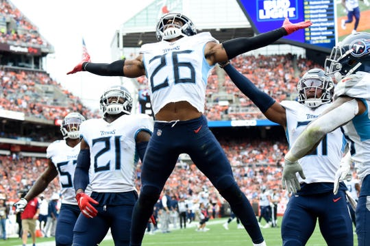 Tennessee Titans cornerback Logan Ryan (26) celebrates his interception with his teammates against the Cleveland Browns during the fourth quarter at FirstEnergy Stadium Sunday, Sept. 8, 2019 in Cleveland, Ohio.