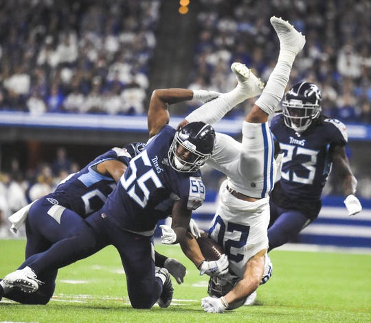 Tennessee Titans inside linebacker Jayon Brown (55) flips Indianapolis Colts running back Jordan Wilkins (20) in the third quarterat Lucas Oil Stadium Sunday, Dec. 1, 2019 in Indianapolis, Ind.