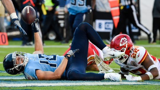 Titans wide receiver Adam Humphries scores the game-winning touchdown past Chiefs free safety Juan Thornhill during the fourth quarter.