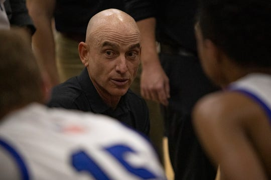 Community School of Naples' boys basketball coach Greg Donahue talks with his team during a timeout during their game against Canterbury School (Ft. Myers),Tuesday, Jan. 21, 2020, at Community School of Naples.