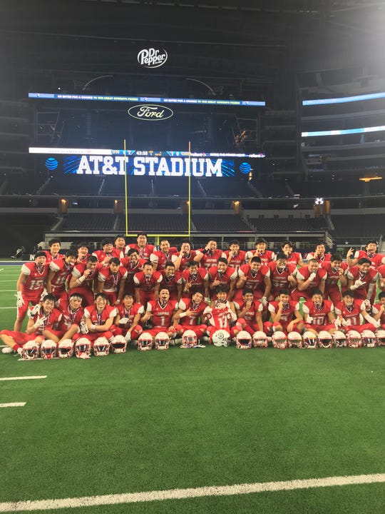 Team Japan poses for a picture after topping the United States 28-20 in the International Bowl at AT&T Stadium in Arlington, Texas.