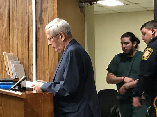 David Cardona entering the court room as his attorney Miles Feinstein awaits.