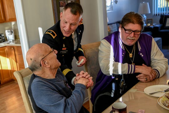 Robert Carlo, a WWII veteran shakes the hand of Mark Piterski, the Deputy Commissioner for Veterans Affairs in his Wayne home on Wednesday January 22, 2020.