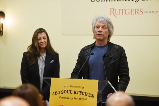 Jon Bon Jovi speaks as his wife Dorothea Bongiovi looks on during a press conference for the first JBJ Soul Kitchen at Paul Robeson Campus Center of Rutgers-Newark on 01/22/20.