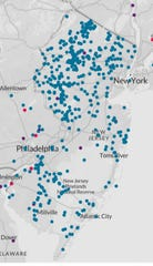 The blue dots show where PFAS compounds have been found in New Jersey drinking water.