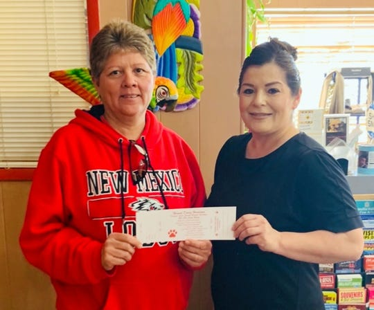 Sylvia Baeza, left, purchased the first ticket to the Deming-Luna County Humane Society's Hound Dawg Hoedown Cash Party in support of the Deming Animal Shelter. At right, Mirna Grado sold the ticket at the la Fonda Restaurant, one of the shelter's main sponsors for the event. Baeza's ticket entitles her to a chance at a $10,000 cash drawing on Saturday, March 21, at the cash party. She could also win $1,500 or $500 in cash.