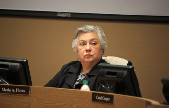 "Las Cruces Board of Education member Maria Flores, pictured during a school board meeting on Jan. 21, 2020, said Tuesday she did not plan to take part in the drive-thru senior celebration event for her own safety and because ""I don't want to be around a lot of car fumes."""