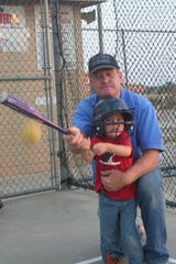 Foye Wells and Charlie Wells at the Scenic Batting Cages in 2011.
