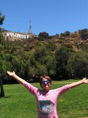 Aztec singer Sophia Rhane Dobbs poses near the Hollywood sign during a visit to Los Angeles in July 2019 to record her debut single