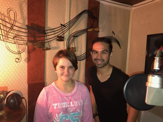 """Sophia Rhane Dobbs poses in a Los Angeles recording studio with her producer Christopher """"C-Ray"""" Roberts in July 2019."""