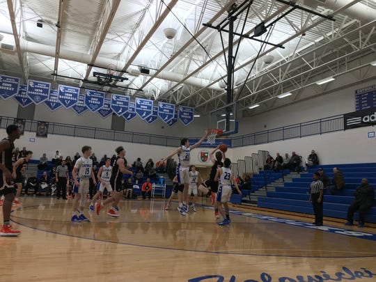 Brother Rice freshman guard Henry Garrity finishes at the rim against Detroit Catholic Central