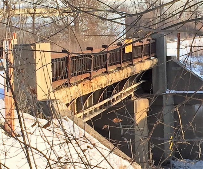 The railroad bridge over Ann Arbor Road is in need of repair, Plymouth Township officials insist.