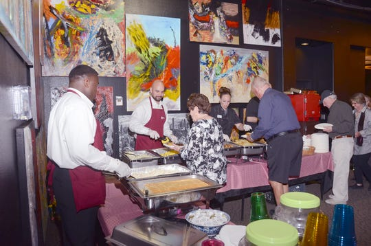 Caterers serve dinner to guests at Desert Theatreworks' 2019 fundraiser. DTW likes to partner with neighboring nonprofit organization The Coachella Valley Rescue Mission to cater their events.