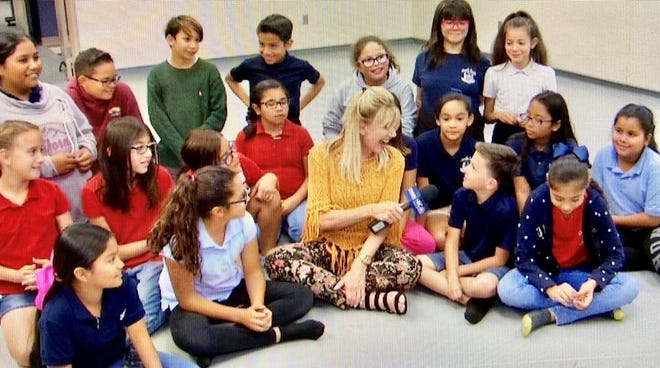 Sandie Newton talks to the kids after a class at Red Hot Ballroom in Palm Desert.