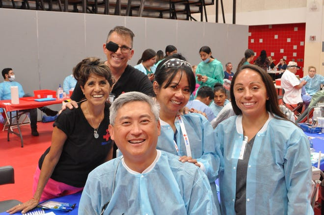 Ines and Tracey Allen, in black, represent IMAHelps as they support The Flying Doctors with their annual medical mission at Desert Mirage High School in Thermal on Sept. 28, 2019.