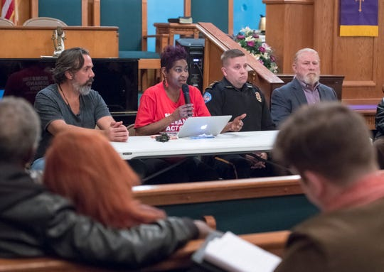 """Cindy Martin with Moms Demand Action speaks Tuesday during the """"Common Unity Against Gun Violence"""" Town Hall at Mount Canaan Baptist Church in Pensacola."""