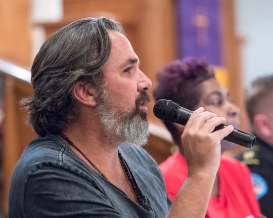 """Manuel Oliver, an advocate against gun violence, speaks Tuesday during the """"Common Unity Against Gun Violence"""" Town Hall at Mount Canaan Baptist Church in Pensacola."""