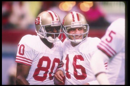 El QB Joe Montana (der.) junto al receptor Jerry Rice durante el Super Bowl XXIV acontra Broncos en Superdome en New Orleans