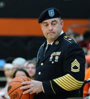A special game ball presentation was made Tuesday night at the Palmyra girls basketball team's game vs. Red Land by Palmyra graduate United States Army/Sargent 1st Class Douglas Cheyney, retired 2005, and in absentia,his son,2019 Palmyra graduate,Seaman 3rd Class Brandon Cheyney,US Coast Guard. The game was part of Palmyra's Military Appreciation Night.
