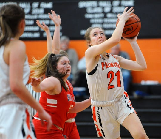Palmyra's Alyssa Marrero (21) drives to the basket for two points during the fourth quarter of play.