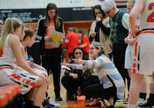 Palmyra head coach Mary Manlove talks to her team during a time-out.